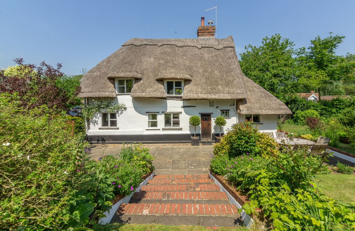 This picture perfect thatched cottage in the Dedham Vale village of Stoke-by Nayland dates back to the 1600s