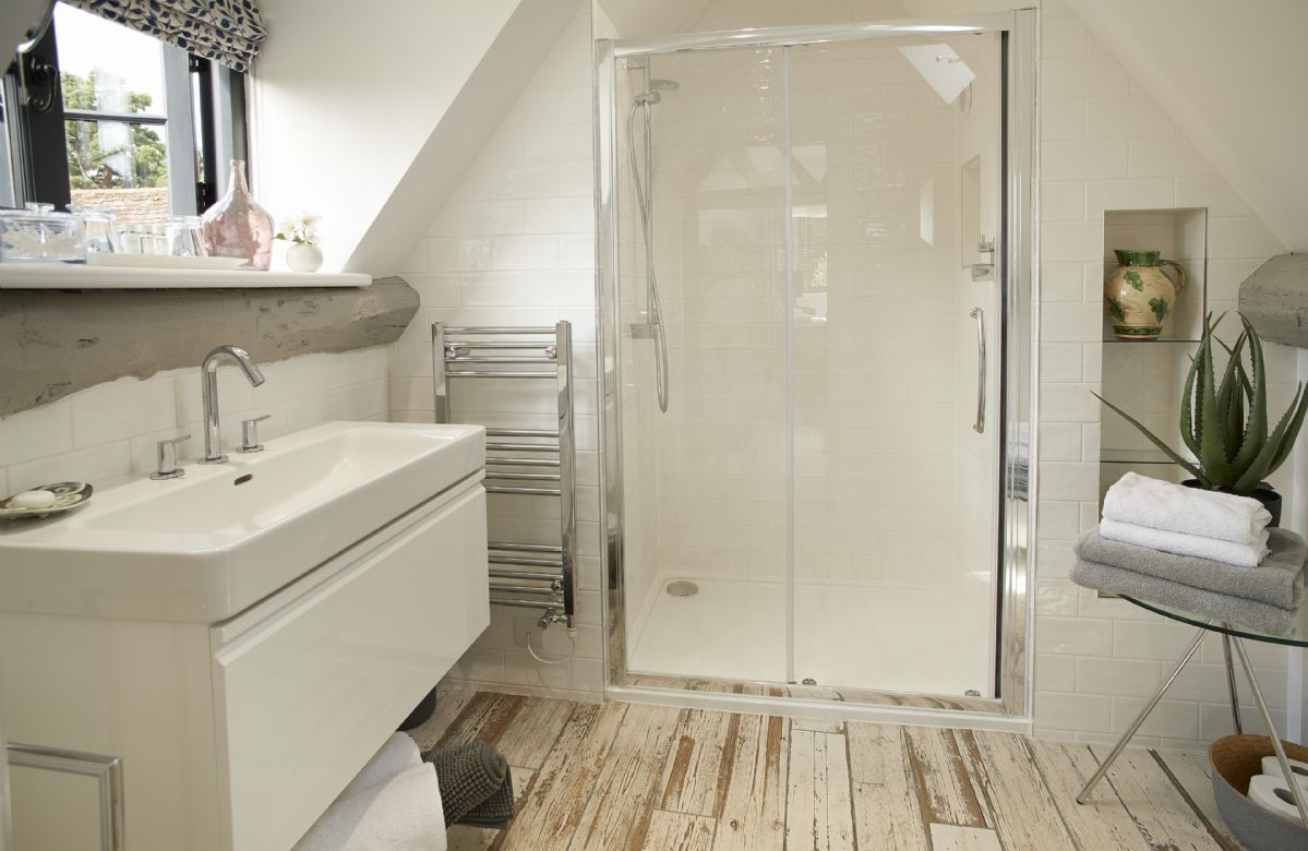 First floor:  Contemporary en-suite with large shower.