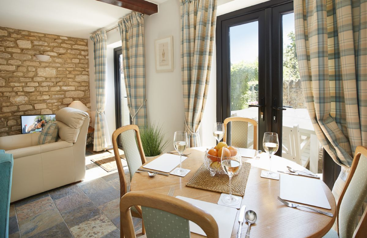 Ground floor:  Open plan sitting/dining room with french doors opening onto enclosed garden.
