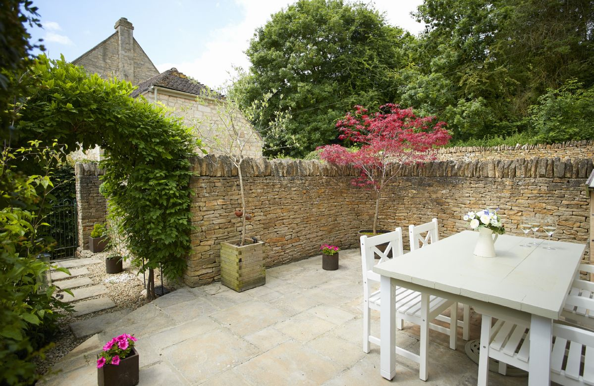 Enjoy alfresco dining in the private outside space.
