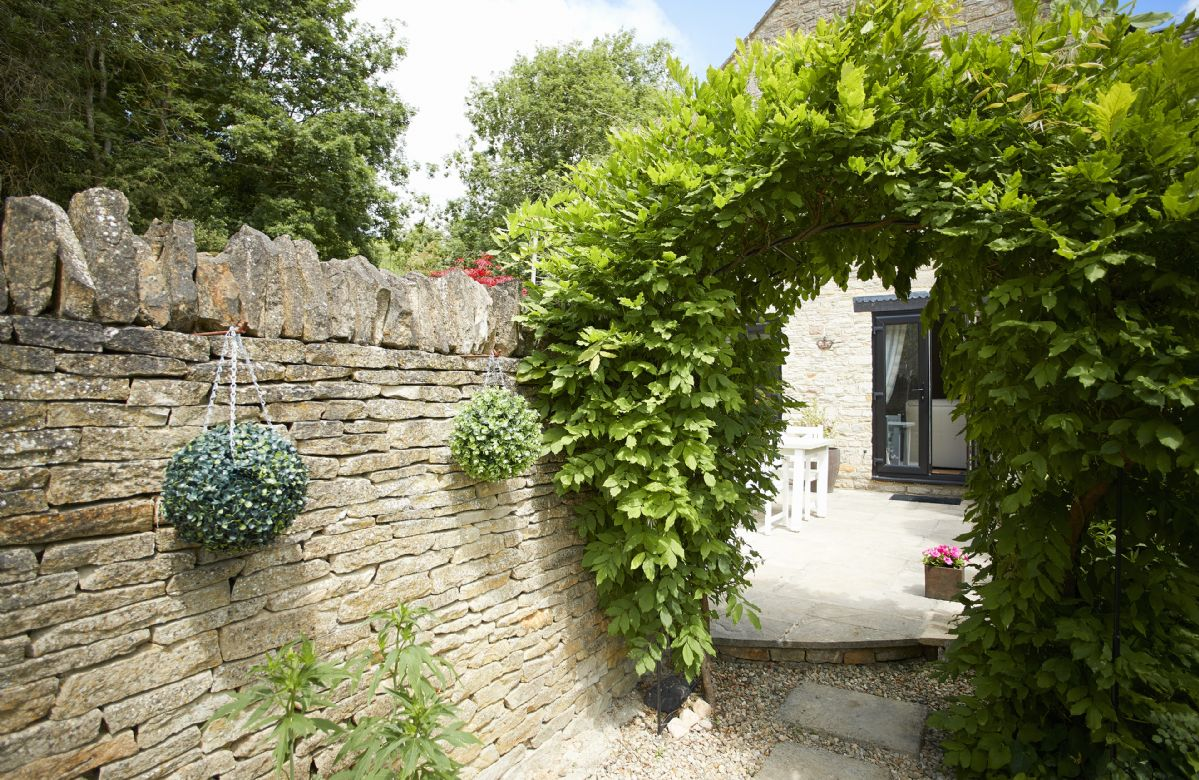 Enter the enclosed garden via this beautiful archway.