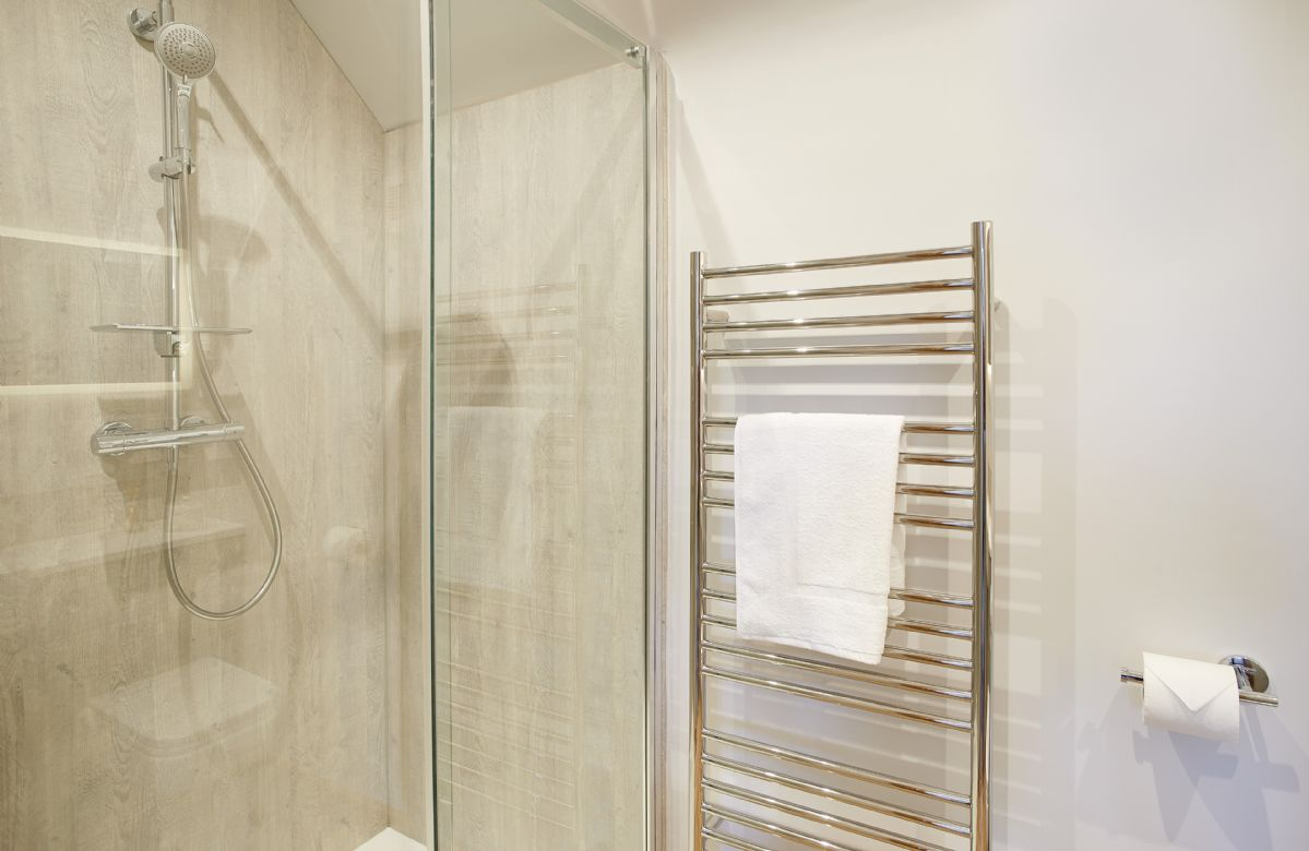 First floor: En-suite  with  spacious shower.