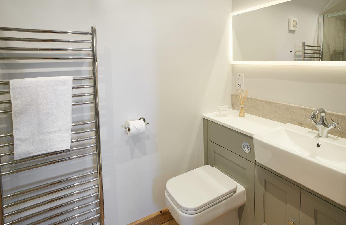 First floor:  En-shower room with heated towel rail.