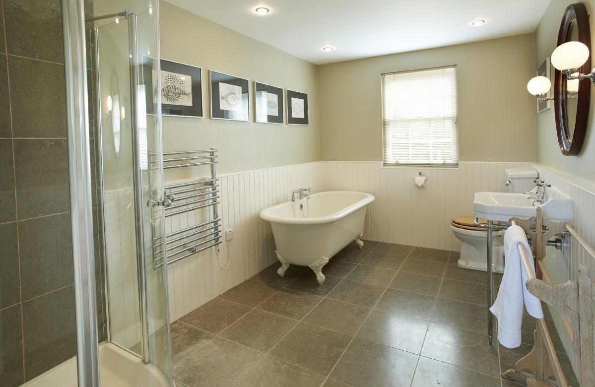 Ground floor: Family bathroom with roll top bath and power shower