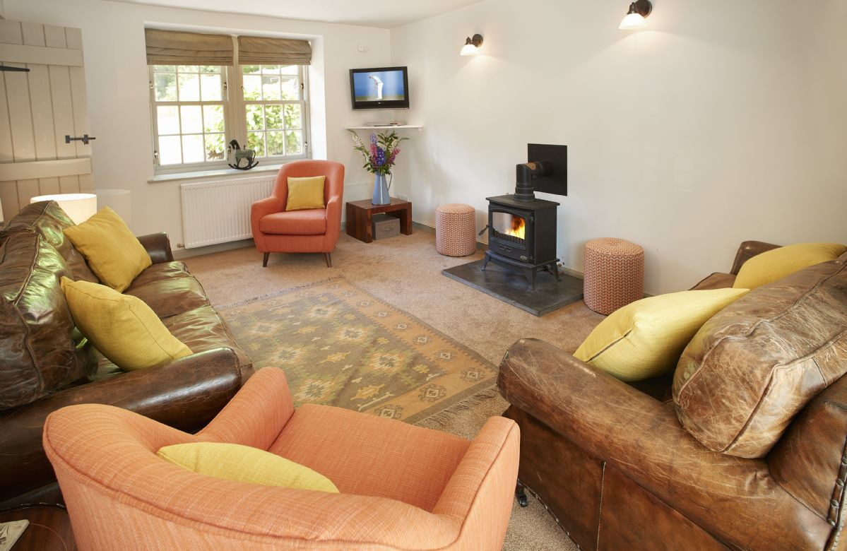 Ground floor:  Relax in the sitting room with wood burning stove.