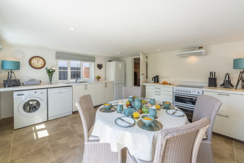 Ground floor: Clean cut kitchen with dining table and four chairs