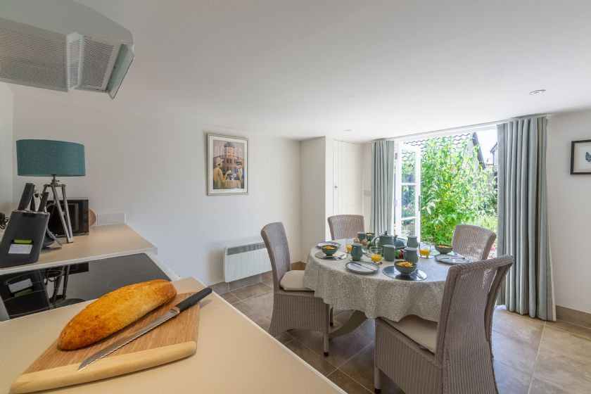 Ground floor: The kitchen has large double doors providing plenty of natural light