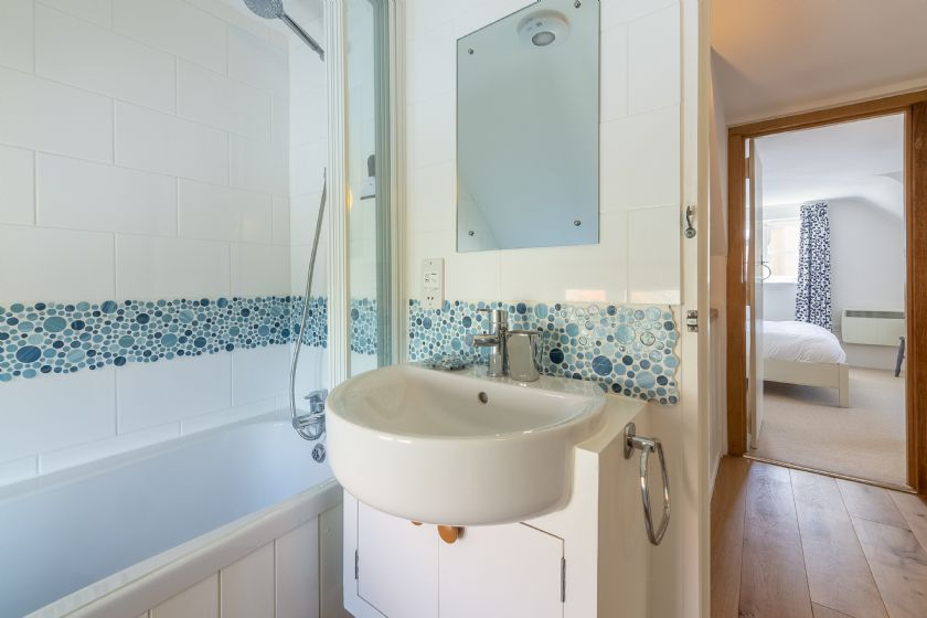 First floor: Bathroom with clean white cut lines