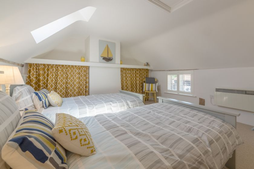 Twin room with windows providing natural light