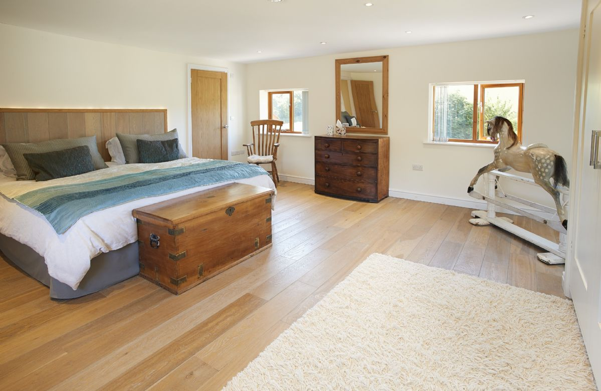 First floor: Master Bedroom with 6' super king size bed with en-suite bathroom with separate shower