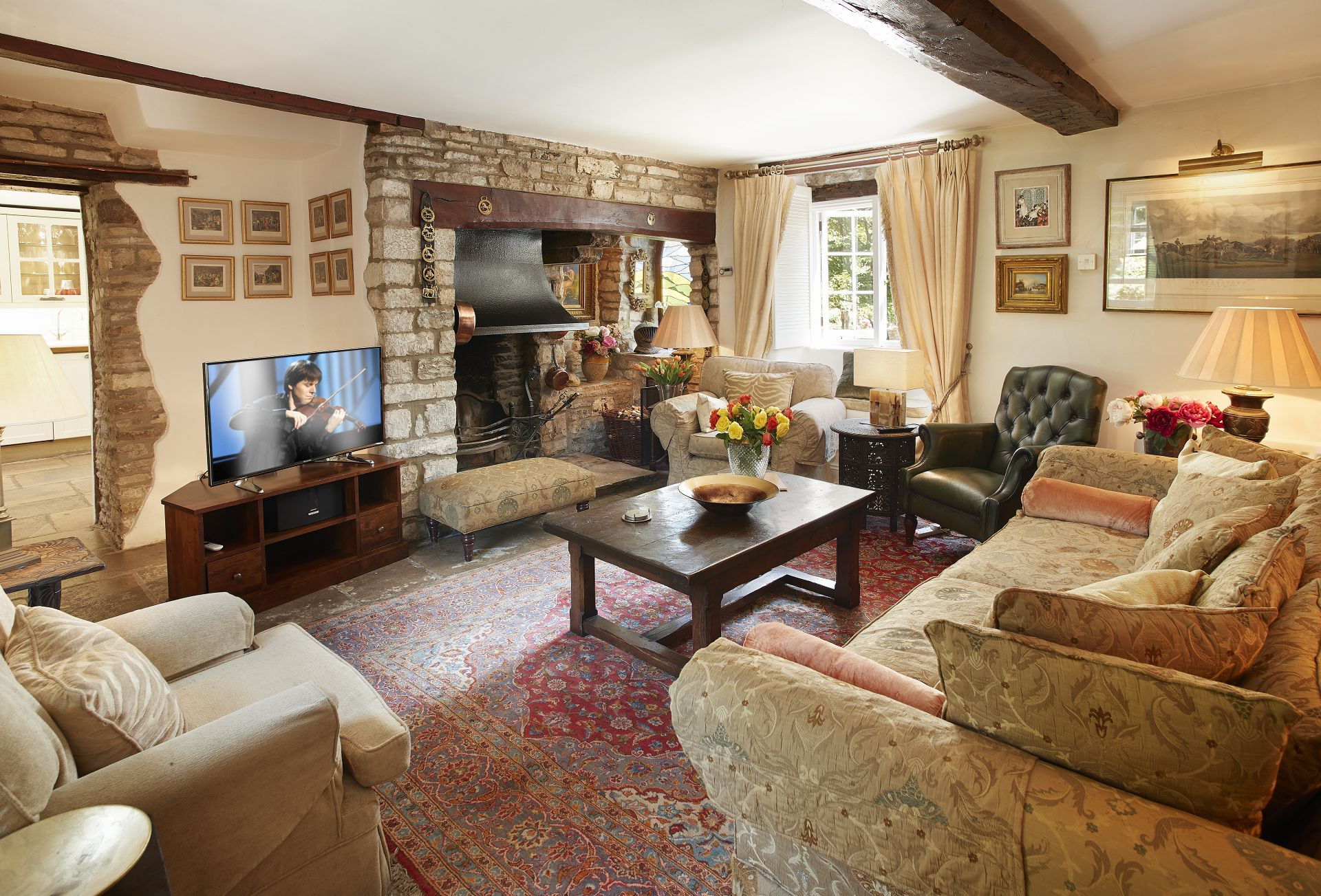 Ground floor:  Sitting room with an inglenook fireplace with an open fire
