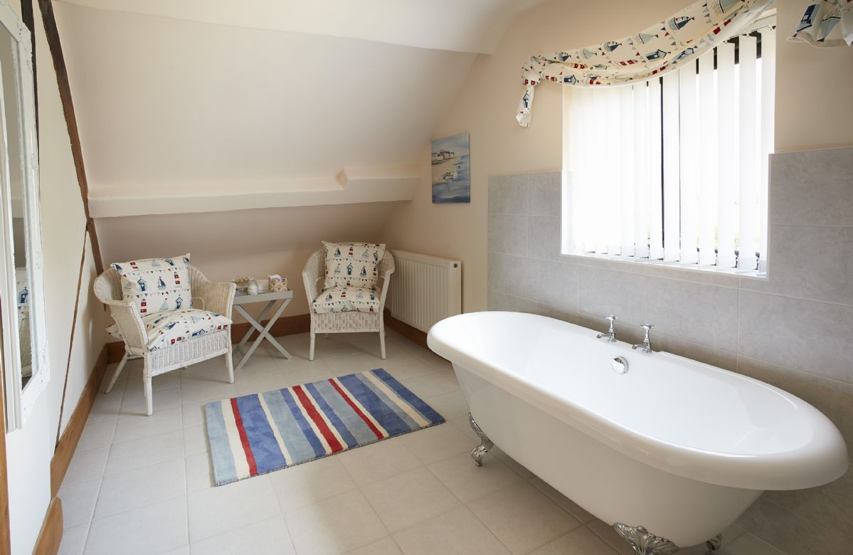Second floor:  Family bathroom with traditional roll top bath