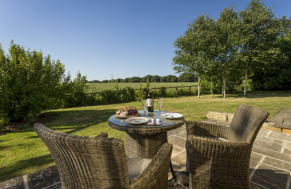 Private large garden and patio area overlooking the beautiful Cotswold countryside