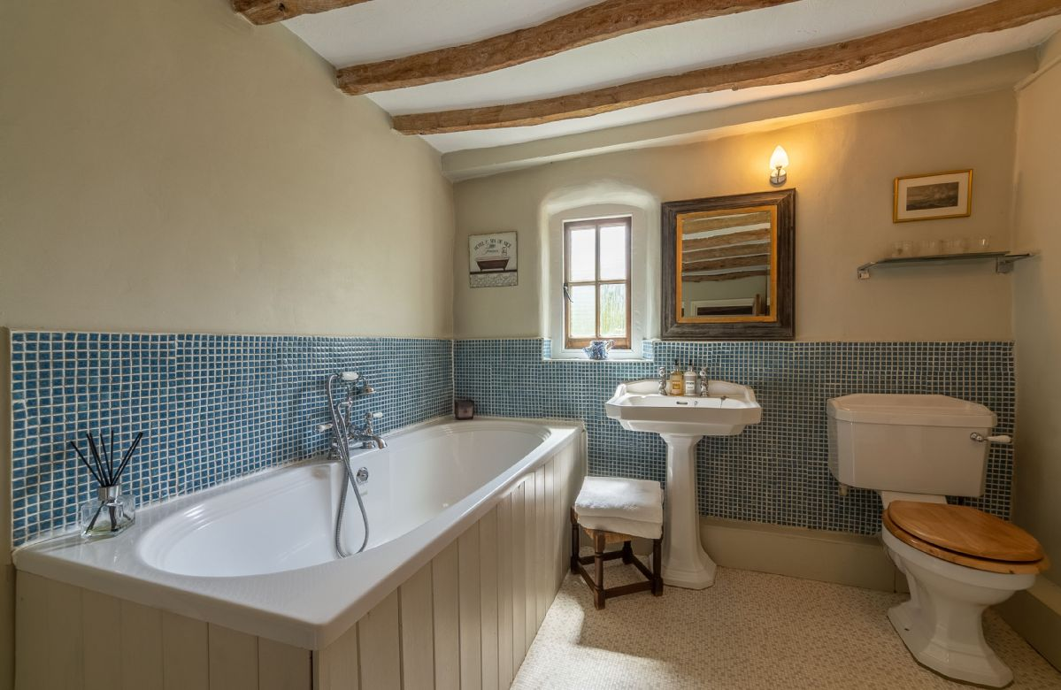 First floor: Family bathroom with bath and hand held shower attachment