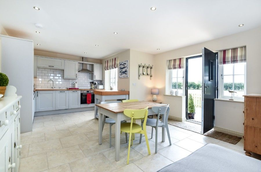 Mill House Lodge | Kitchen with dining