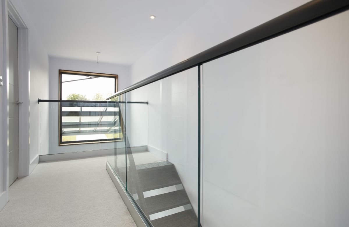 First floor:  Contemporary stairs leading to bedrooms