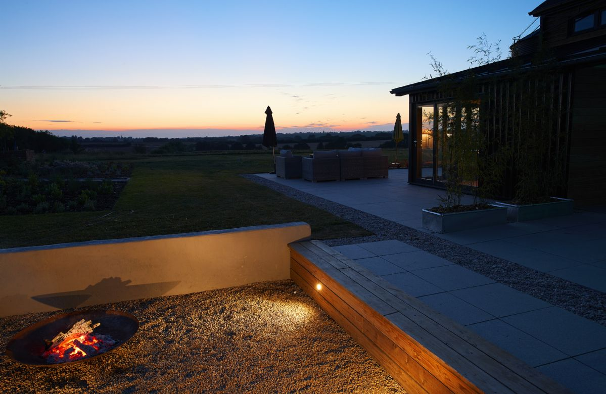 Light the fire pit and watch the sun set in the evening