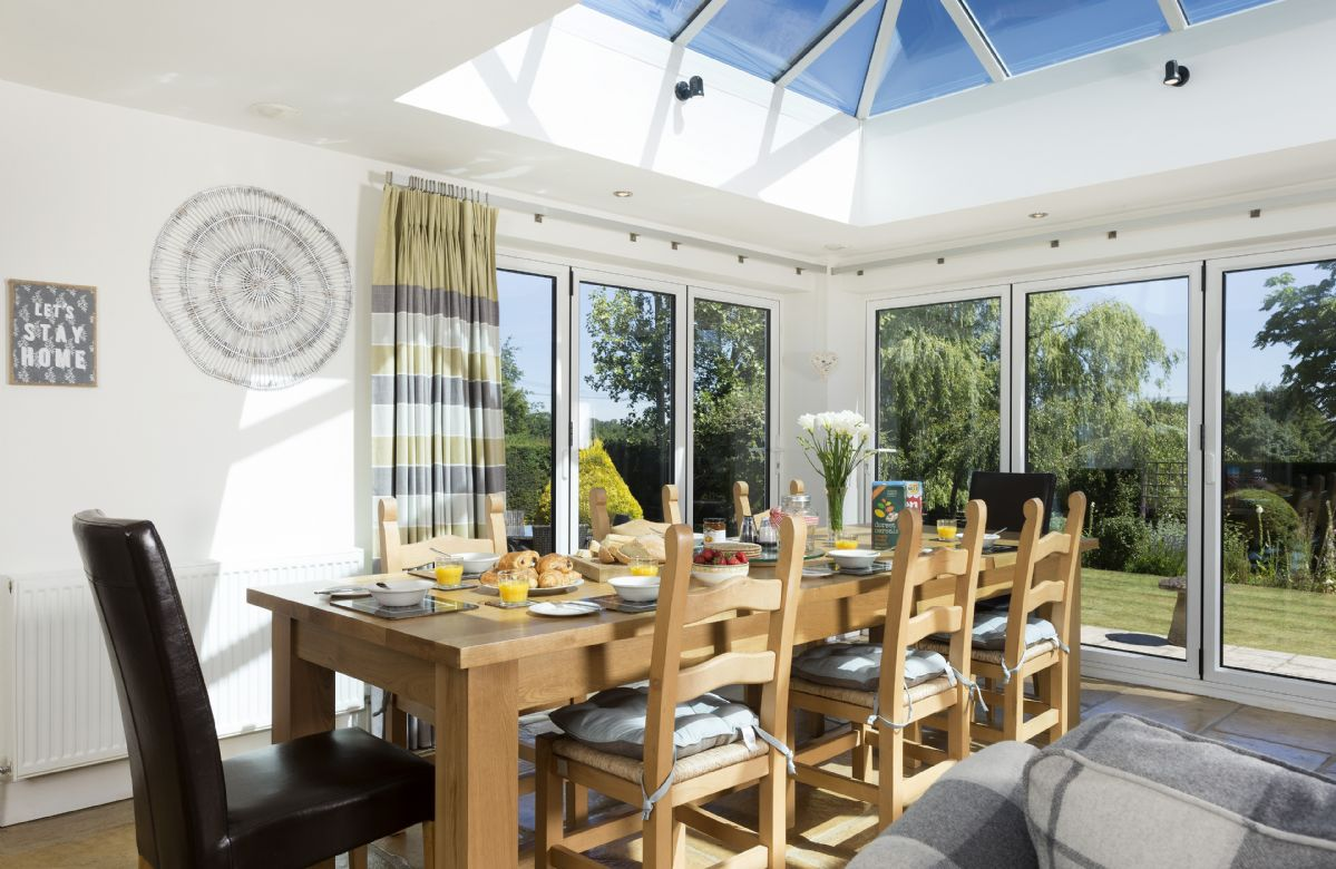 Ground floor: Light and spacious dining area with doors opening to rear garden.