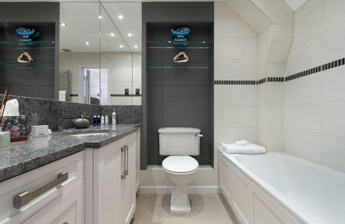 First floor:  En-suite bathroom and shower.