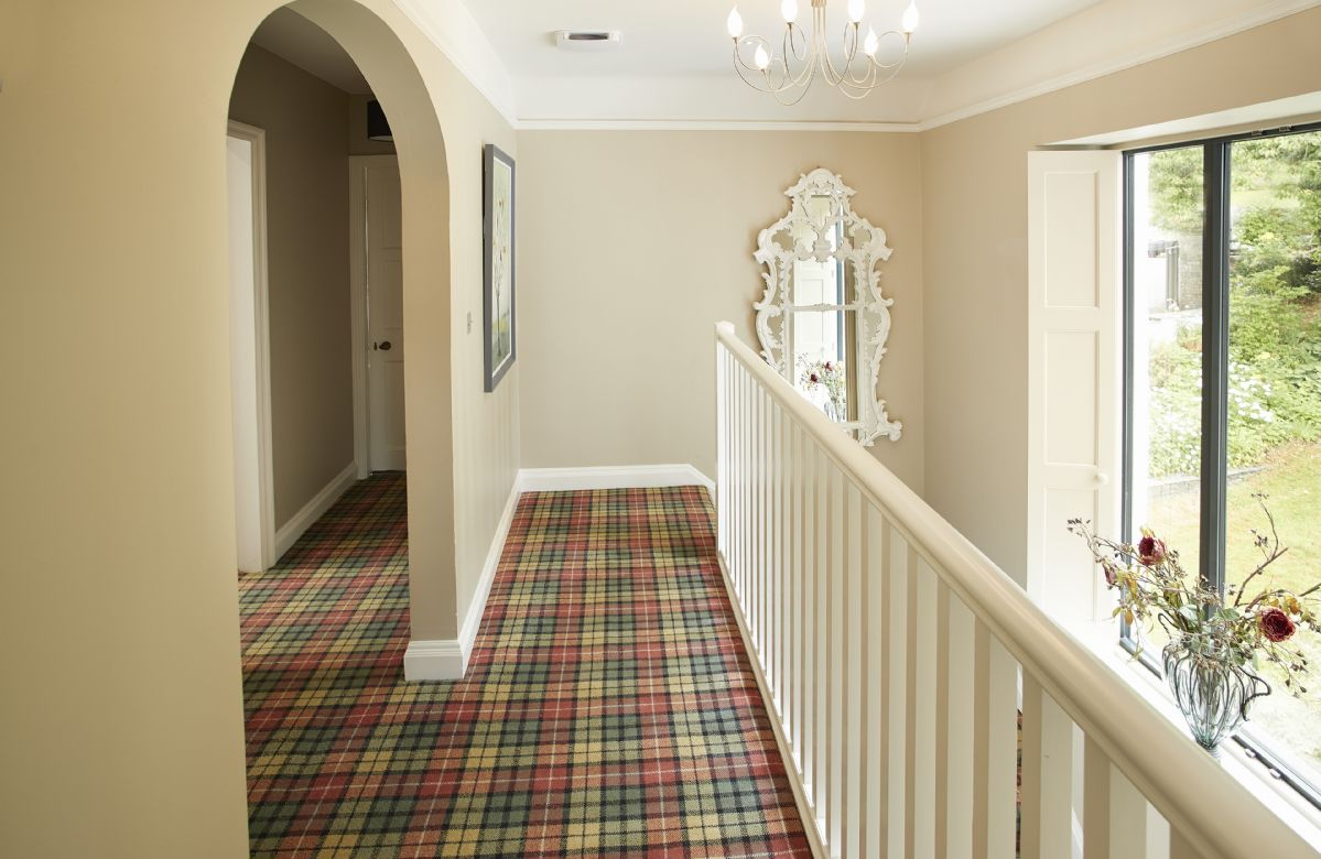 A traditional, feature staircase with large picture window overlooking the grounds leads to the first floor