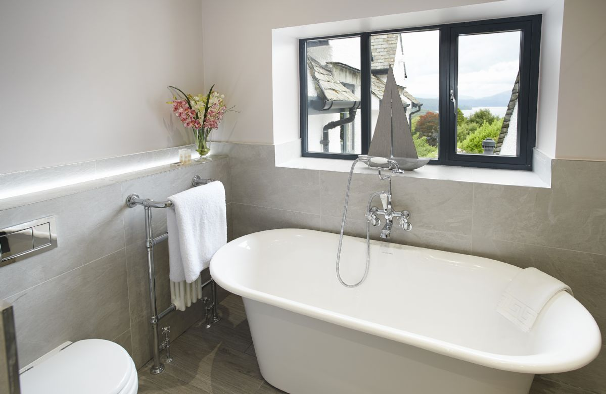 First floor: Modern family bathroom with traditional features, roll top bath and large walk-in shower