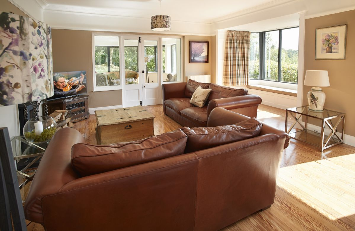 Ground floor: Beautiful sitting room with patio doors and bay window with views across the Lake