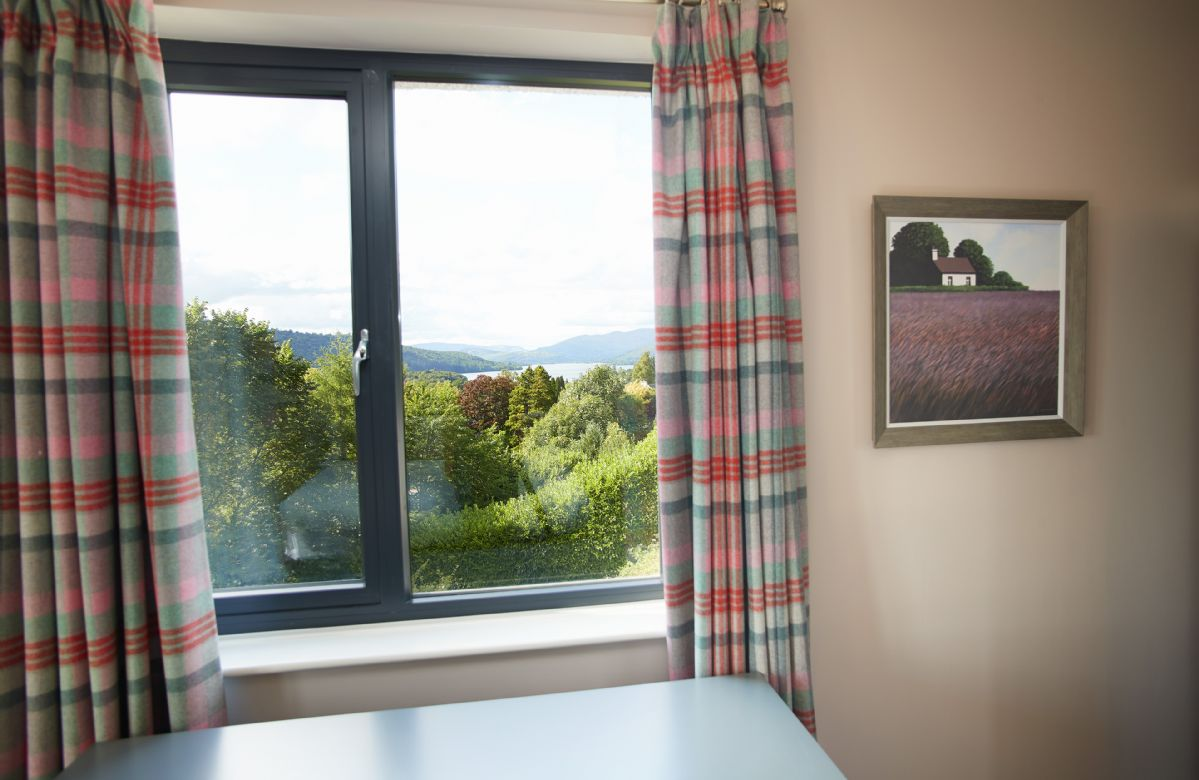 First floor: Fifth bedroom with triple aspect views, flat screen TV and en-suite shower room