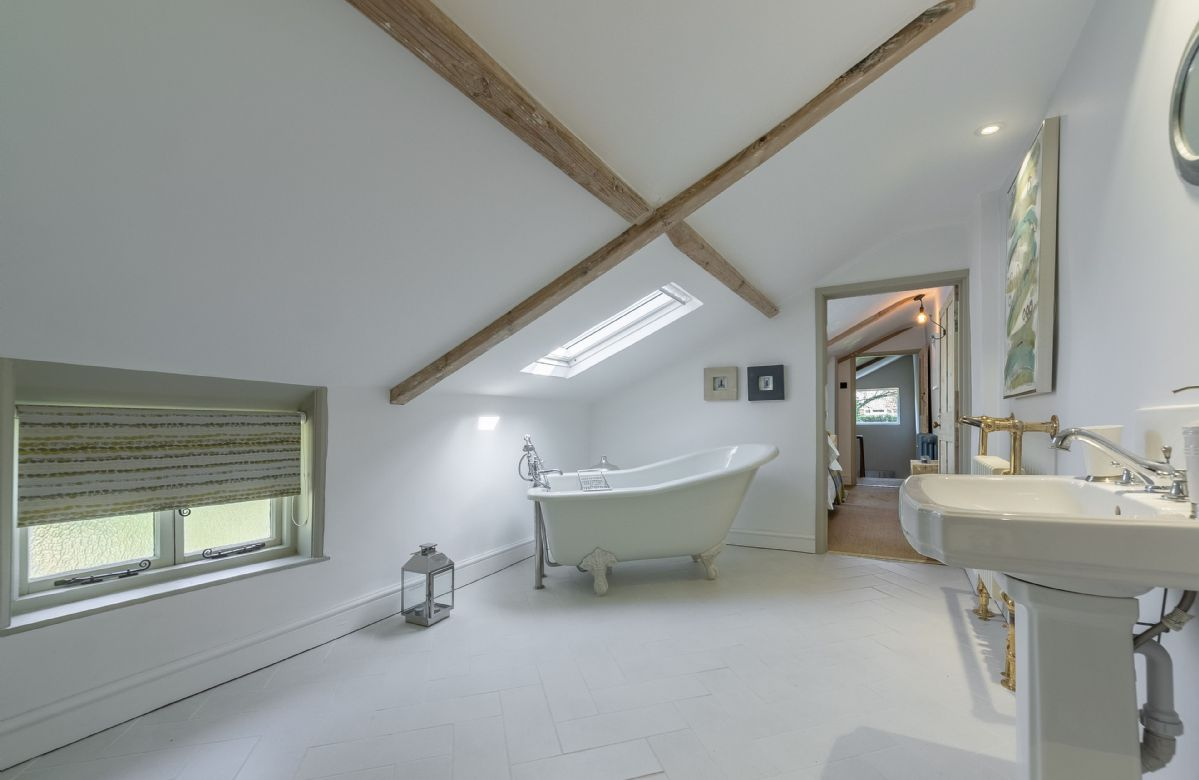 First floor:  En-suite bathroom with roll top bath