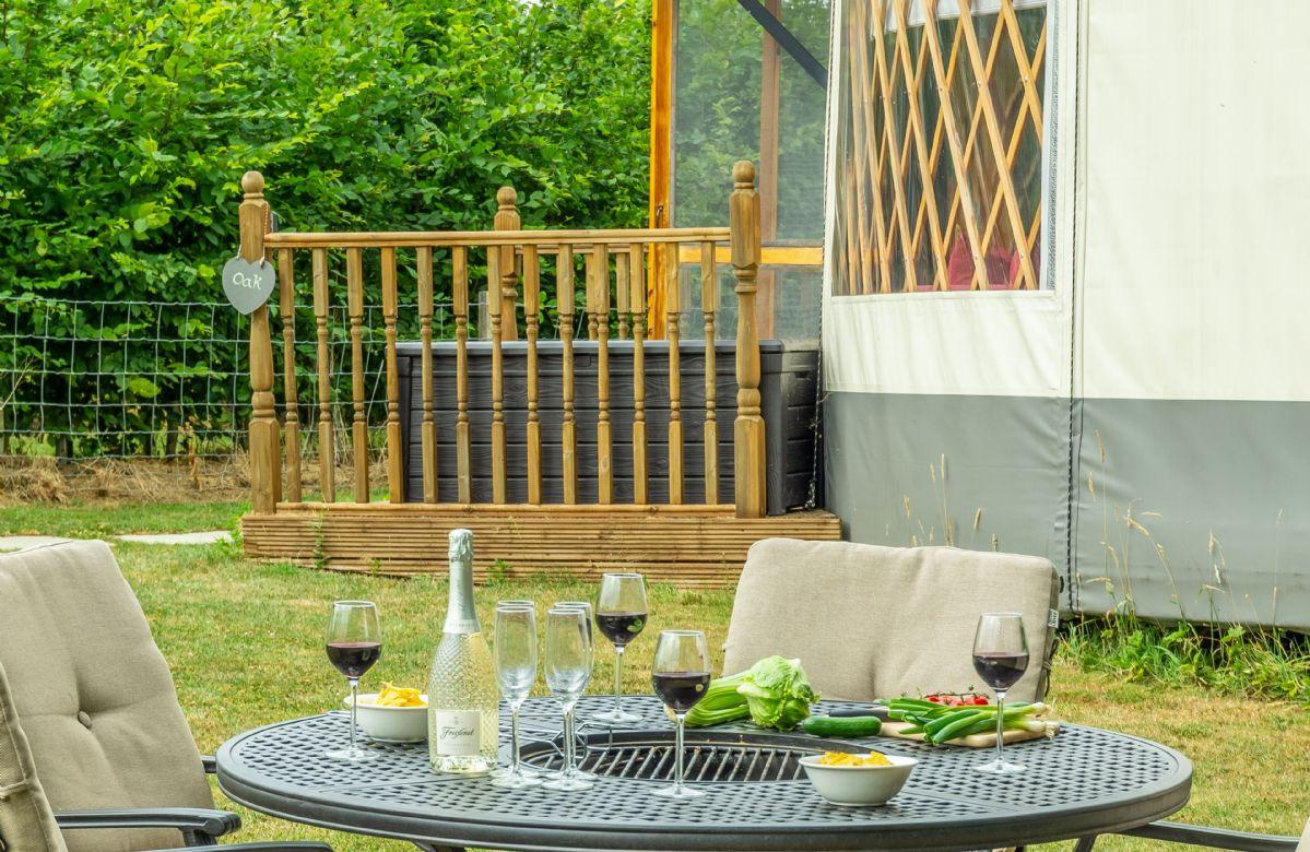 Outdoor dining at Oak Yurt