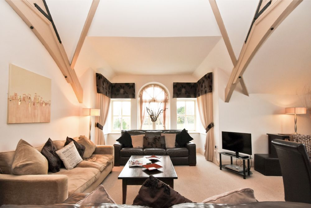"""""""The open plan upstairs living room and kitchen was very comfortable. Perfect for two families."""""""