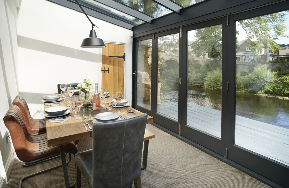 Ground floor:  River room with dining table seating six and bi fold doors opening onto decking