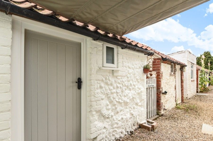 Shingle Cottage | Door to boot room/utility room