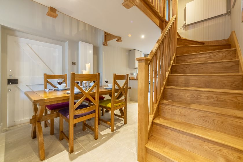 Ground floor: Open plan dining area and staircase