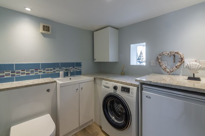 Ground floor: Utility room with washing machine and WC