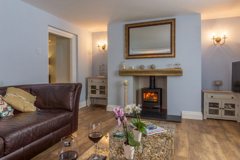 Cosy up in front of the log burner in the spacious sitting room