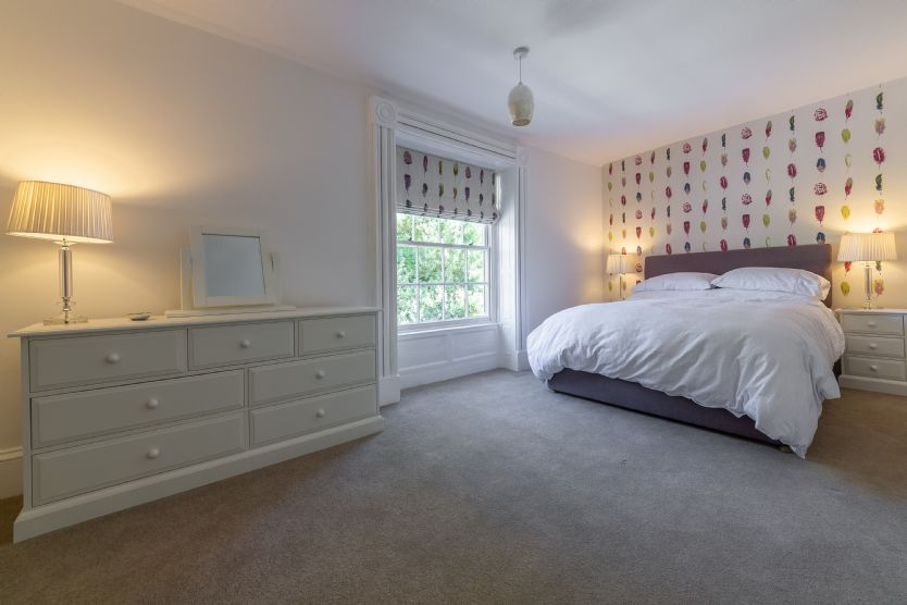 First floor: Bedroom two features a super-king size bed with views to the front ...