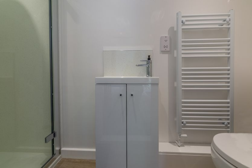 First floor: Bedroom two en-suite has a  digitally controlled shower