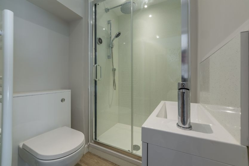 Master en suite with a digitally controlled shower