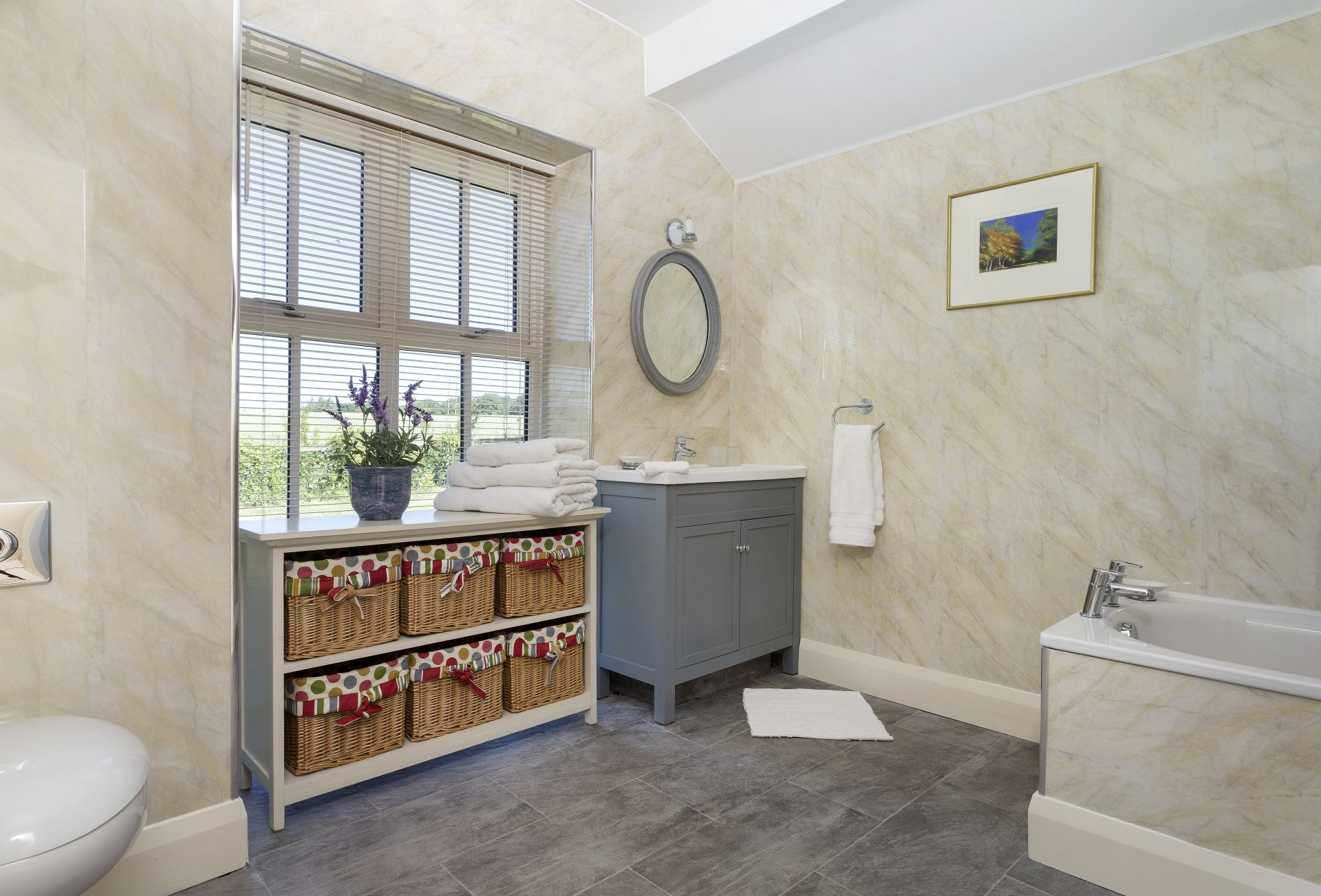 Ground floor: Generous en-suite bathroom with separate shower