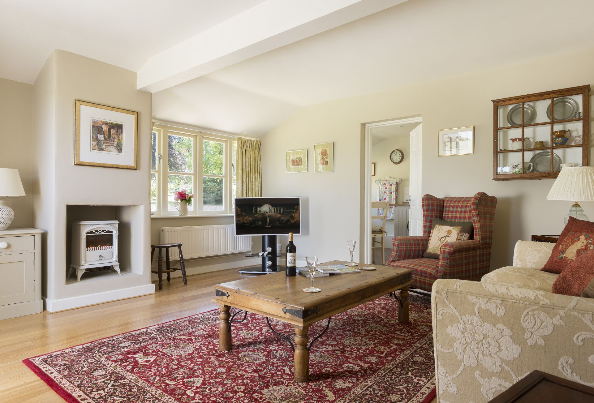 Ground floor: Sitting room with electric wood burner style stove