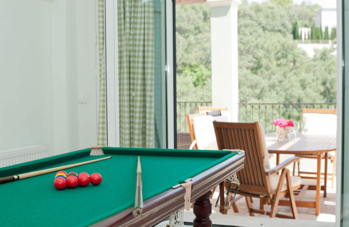 Ground floor: Games room with snooker table and French windows to the veranda
