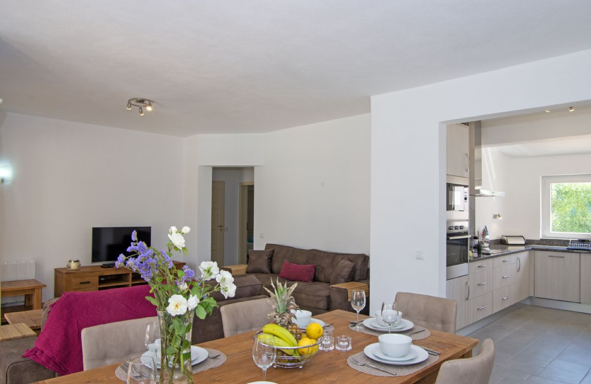 Ground floor: Open plan living/dining area leading to modern fitted kitchen