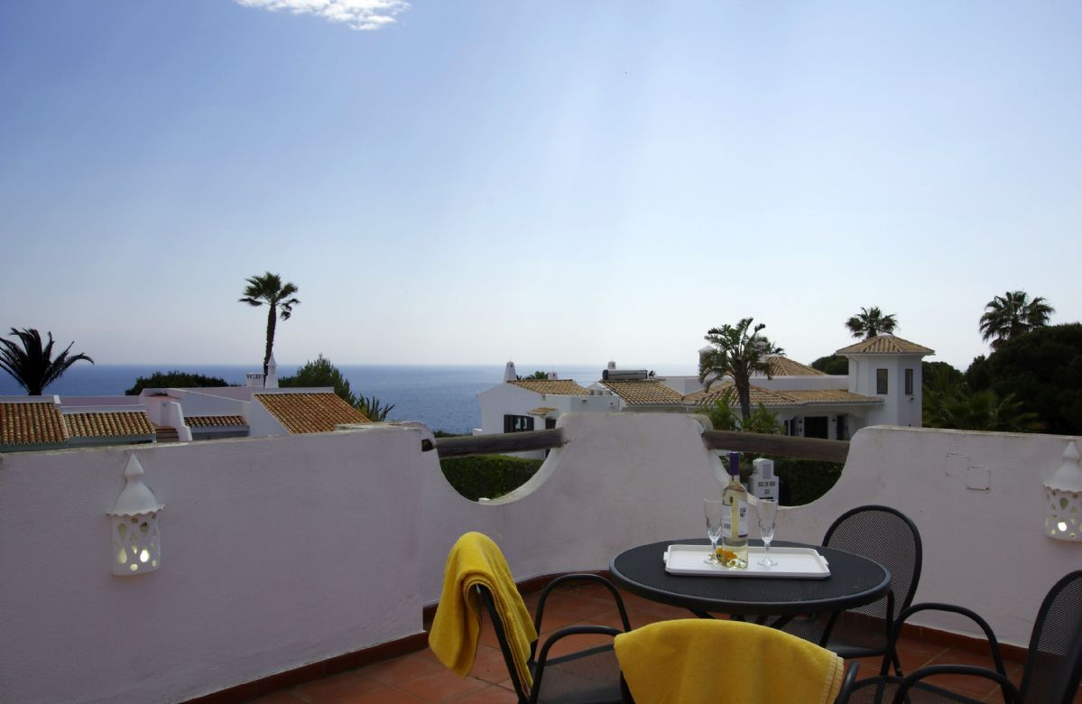The property is in a secluded part of the resort, with views from the roof terrace that look out over the sea beyond