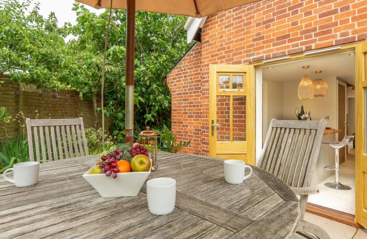 Garden furniture to relax in this small peaceful garden
