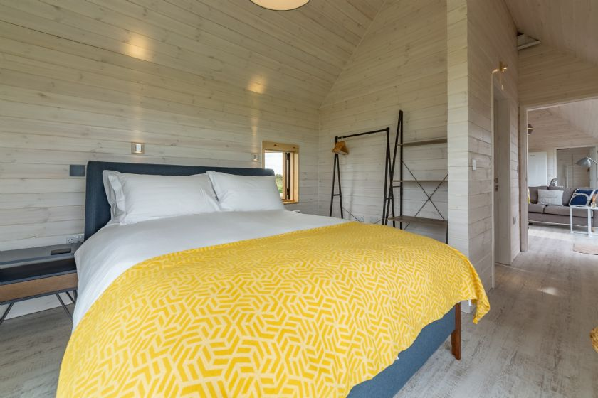 King size bed, sea views, en-suite bathroom containing bath and overhead shower.
