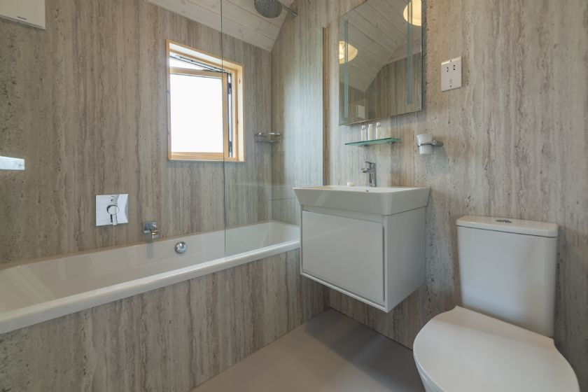 Ground floor: Spacious and contemporary bathroom to the master bedroom