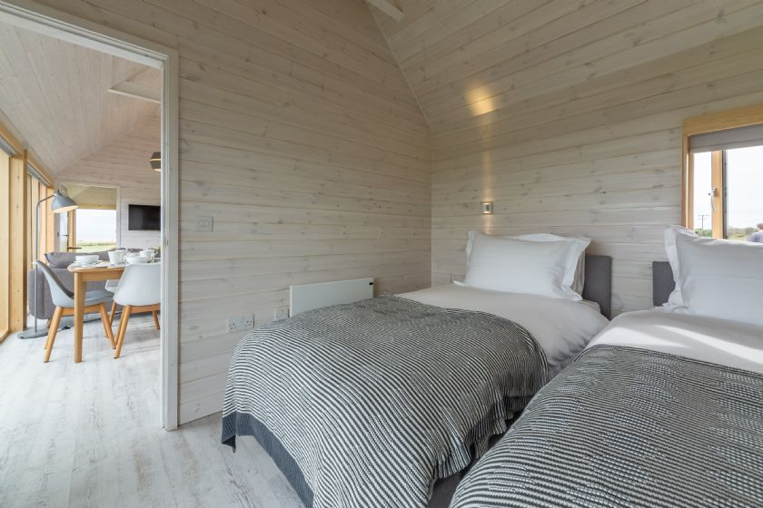 The Listening Station: Super-king zip and link bed with sea views and en-suite shower room
