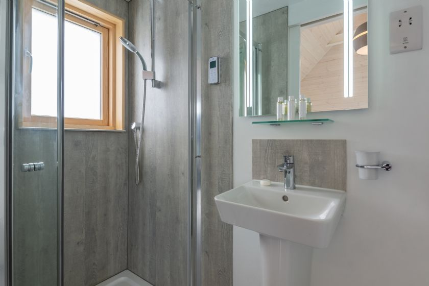 The Listening Station contemporary en suite shower room to the twin bedroom.