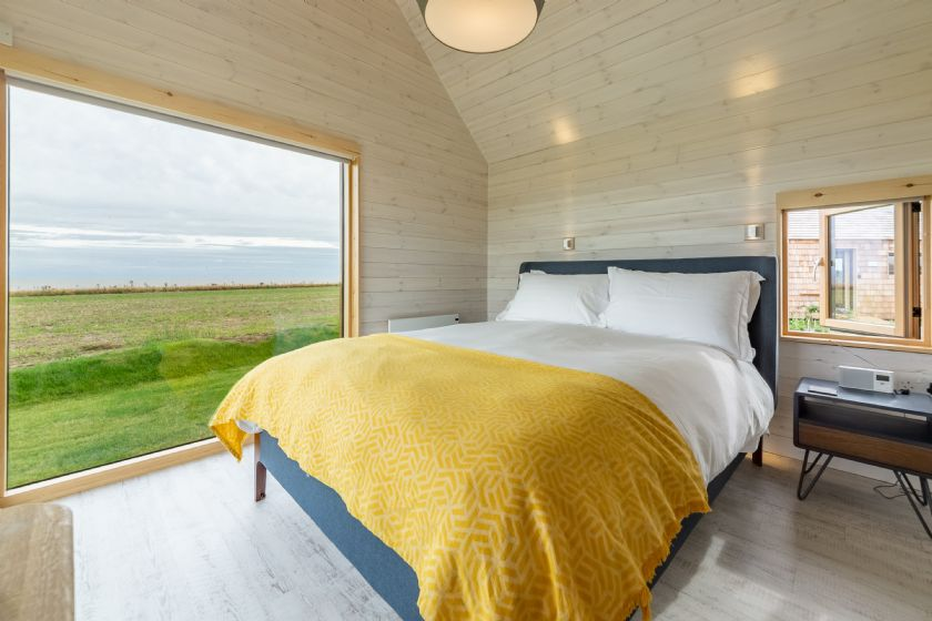 The Listening Station King size bed, sea views, en-suite bathroom containing bath and overhead shower.