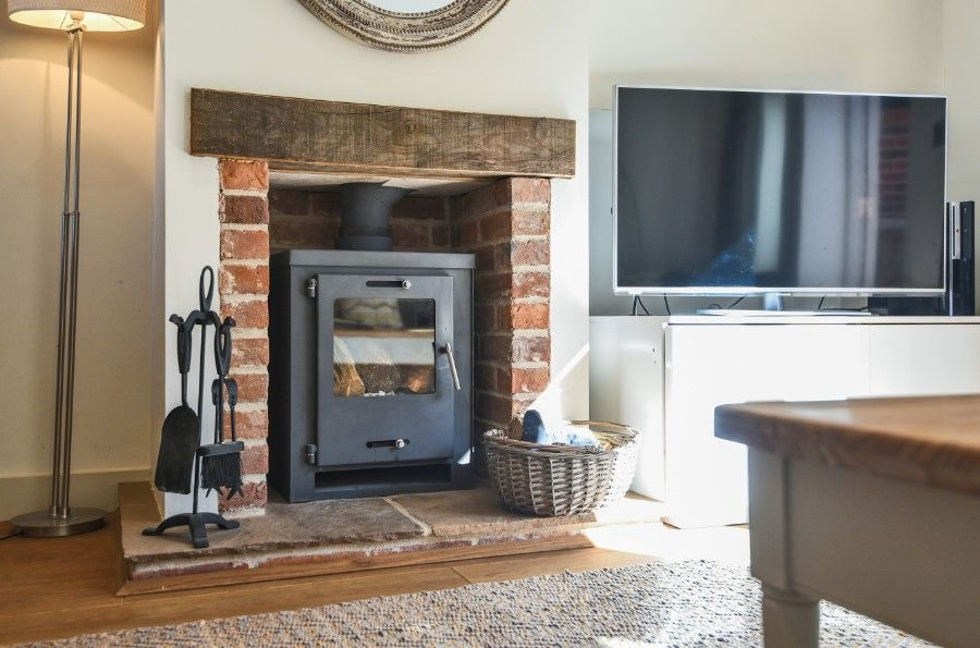 Harrier Cottage in Thornham | Fireplace
